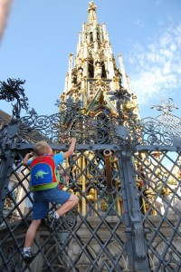 James is spinning the mythical (and touristy) brass ring in the fence - make a wish!